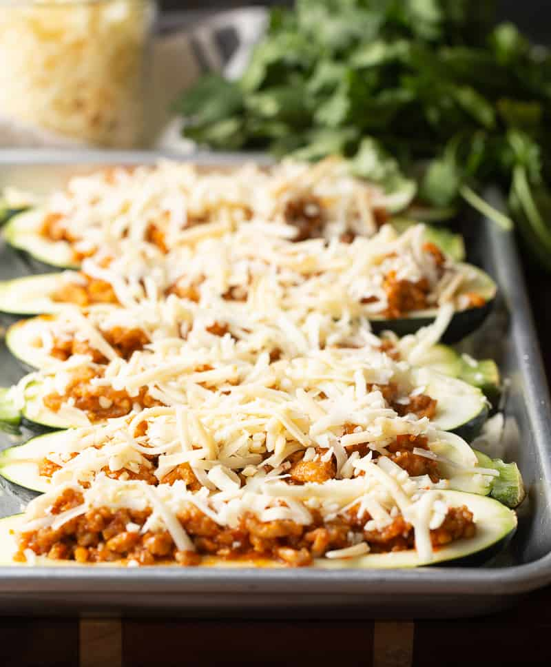 Zucchini Boats stuffed with chicken and topped with cheese