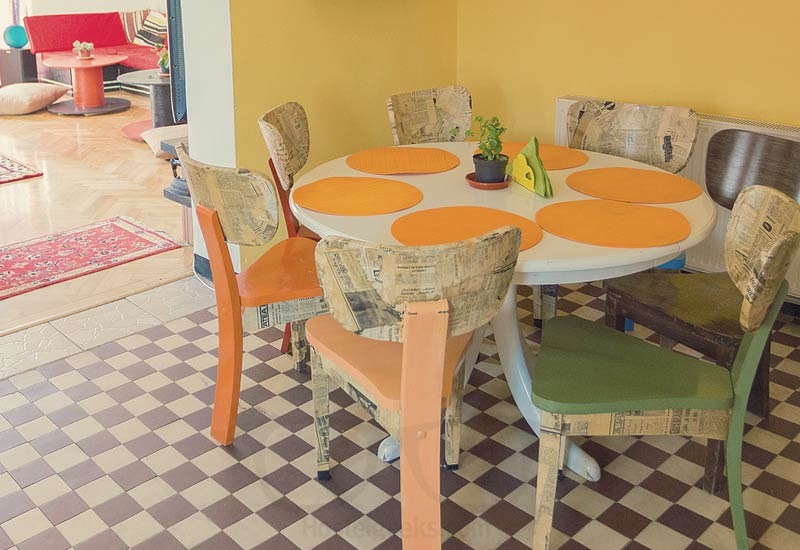 The decorated chairs in the kitchen at Spot Cosy Hostel in Cluj