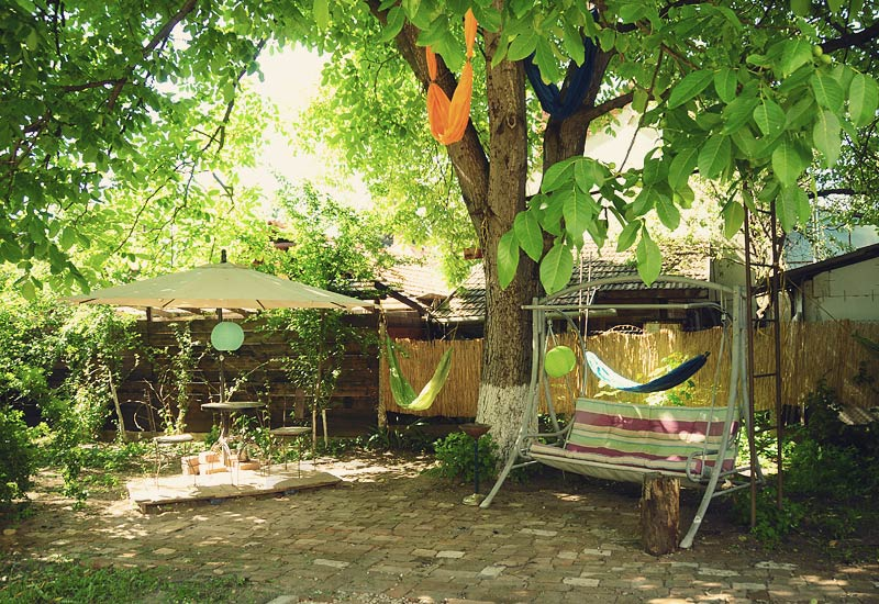 The Green Hostel Garden - which hammock do you choose? The ones in the tree?