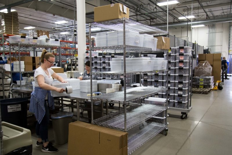 woman packaging in a facility