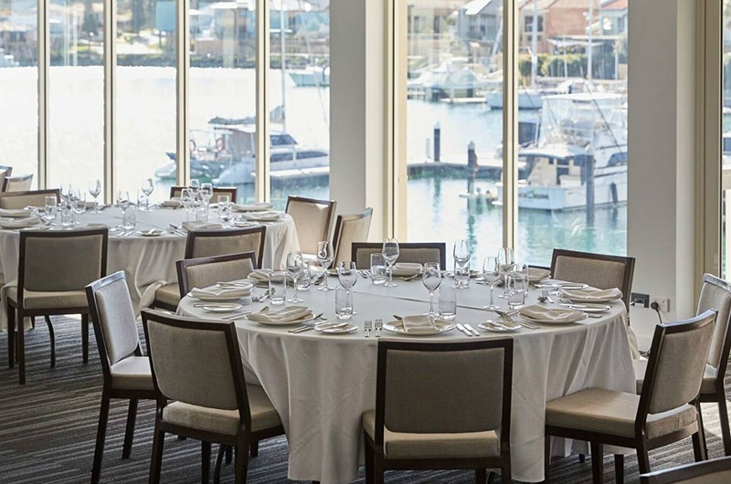 Round Tables Set Up For A Business Function With Views Over Mindarie Marina