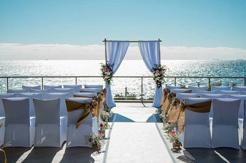 Chairs Set Up For On A Terrace For A Wedding Ceremony Next to the Ocean