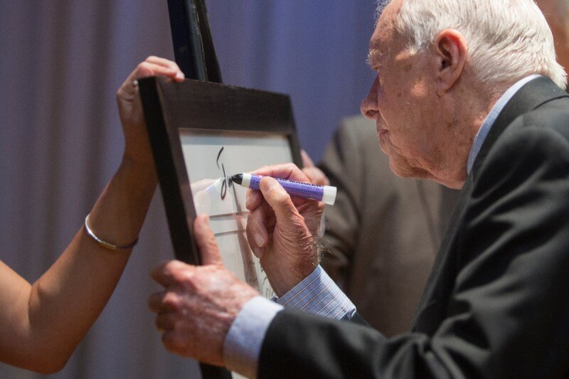 Former President Jimmy Carter signed Brenau University's print of a Jimmy Carter portrait done by Andy Warhol after his question and answer session with the school's first-year students.