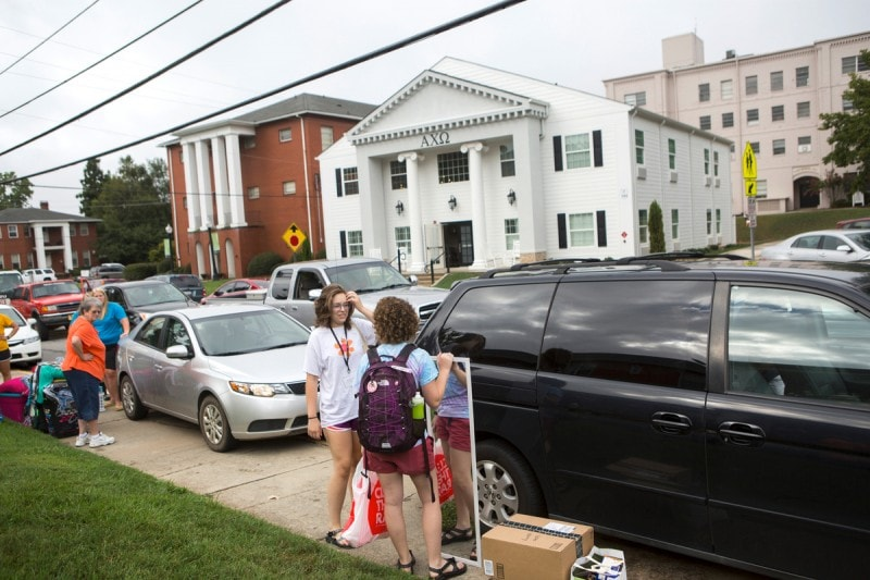 Health science student Allie McConnell starts to move in her belongings with the help of her sister Kylie Tuesday, August 18.