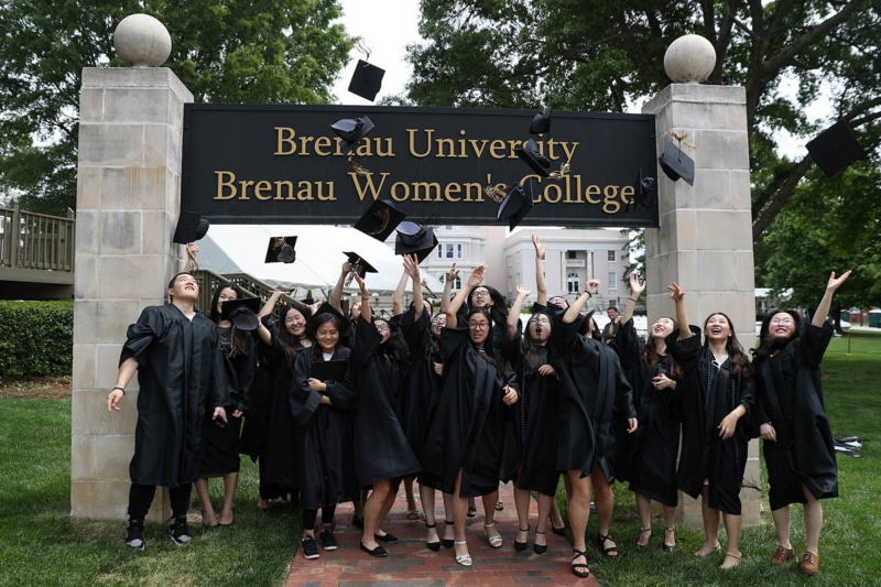 ANU-Brenau University students throw their mortarboard into the air Saturday May 5, 2018 in Gainesville, Ga. (Jason Getz for Brenau University)