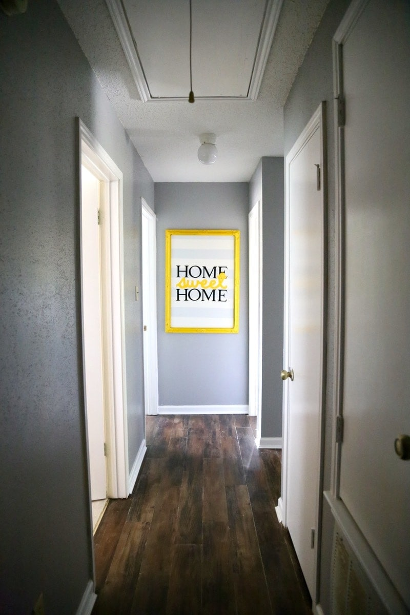 Hallway with bright yellow art