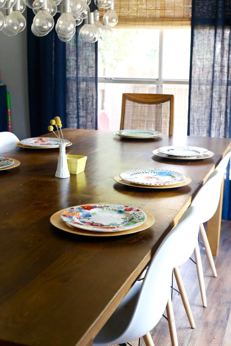 A dining table set with Anthropologie plates