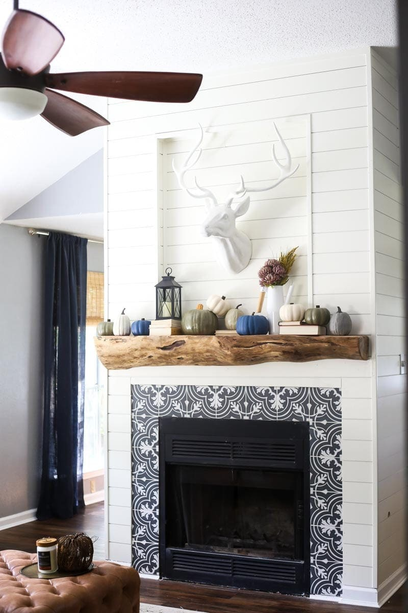 A gorgeous DIY fireplace renovation, and before and after photos of a living room makeover
