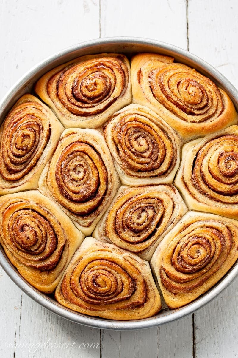 Close up of a pan of fresh from the oven cinnamon rolls