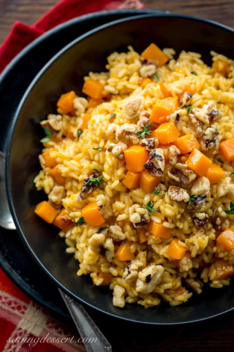 A bowl of butternut squash risotto with candied walnuts