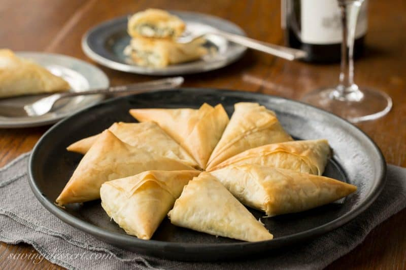 Spanakopita Recipe - the popular and delicious Greek recipe for Spinach and Feta Pie is now a finger-friendly appetizer! www.savingdessert.com