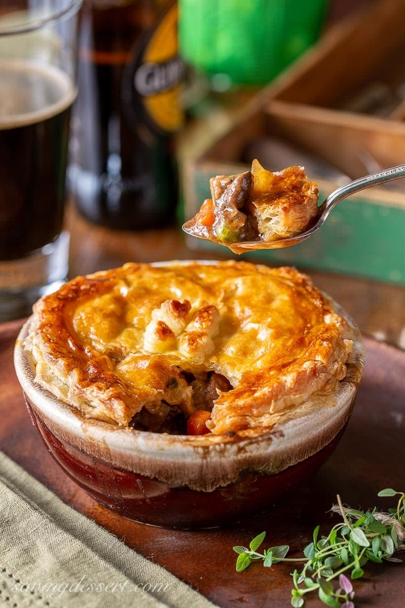 A spoonful of Irish beef pie with puff pastry on top