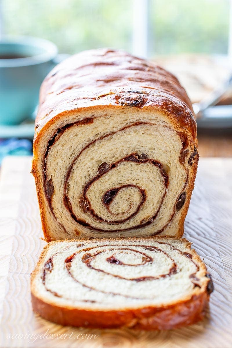 A sliced loaf of cinnamon raisin swirl bread