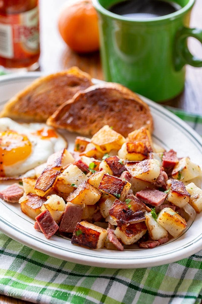 A plate of corned beef hash with a fried egg and toast