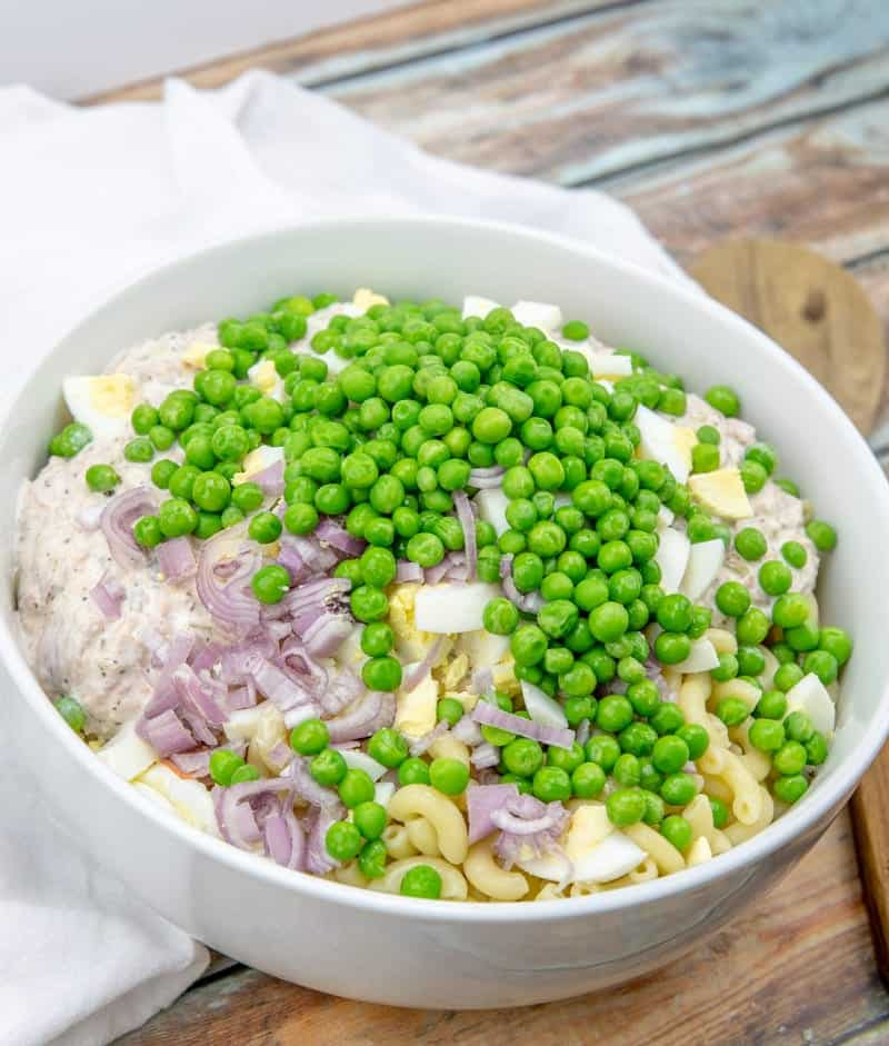 cooked macaroni, diced shallots, peas, chopped eggs added to tuna mixture