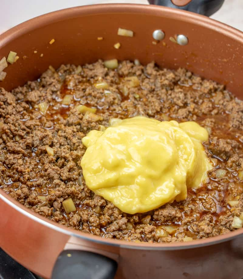cooked ground beef, taco seasoning, cream of chicken in large skillet