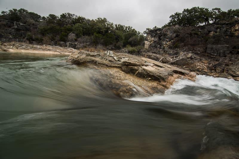Water swirling around a corner in Pedernales Falls State Park