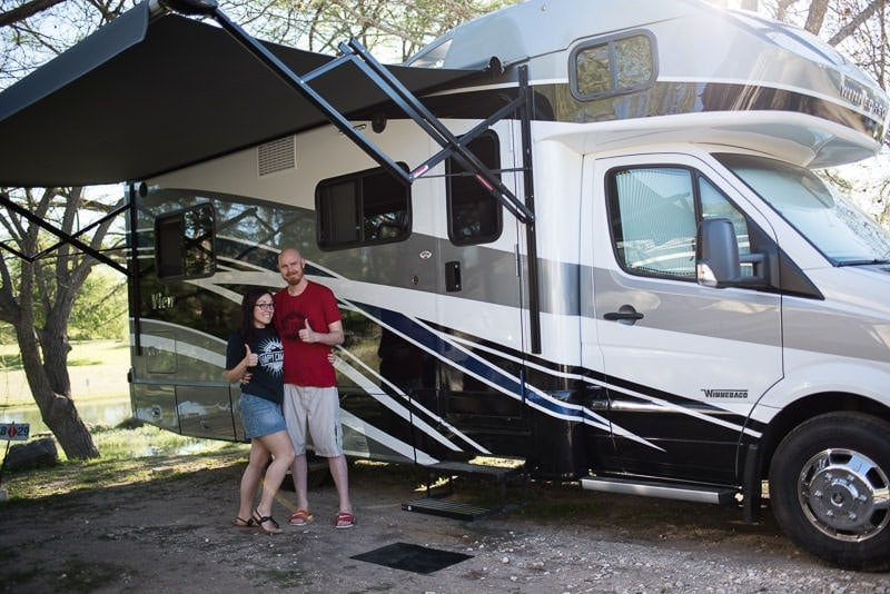 Brooke and Buddy posing outside their new Winnebago View