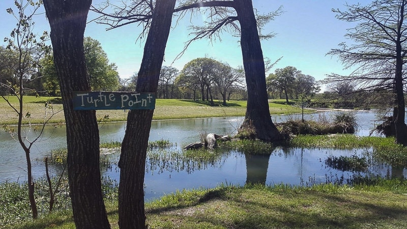 Sign that says 'Turtle Point' at by the river RV Park in texas that we sat by while learning to embrace slow travel