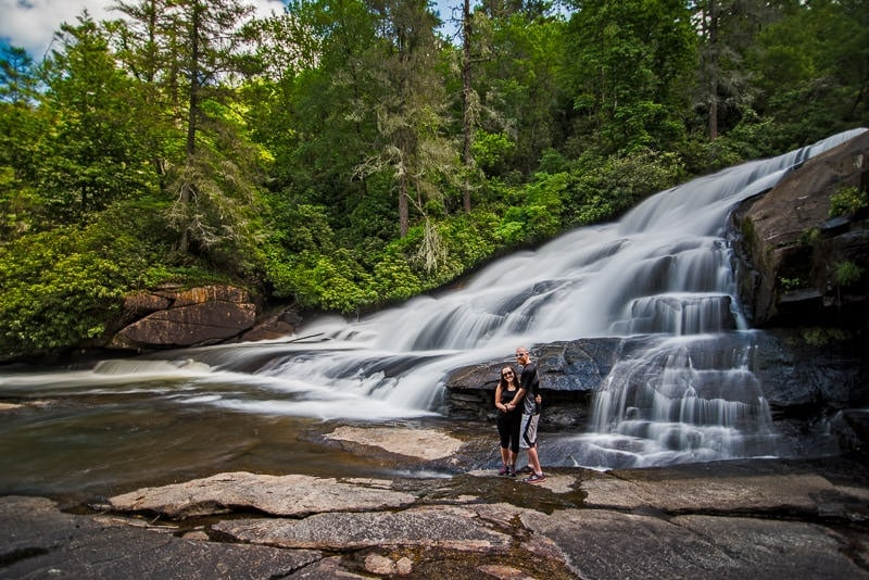 Brooke and Buddy at the base of triple falls in Dupont State Forest north carolina
