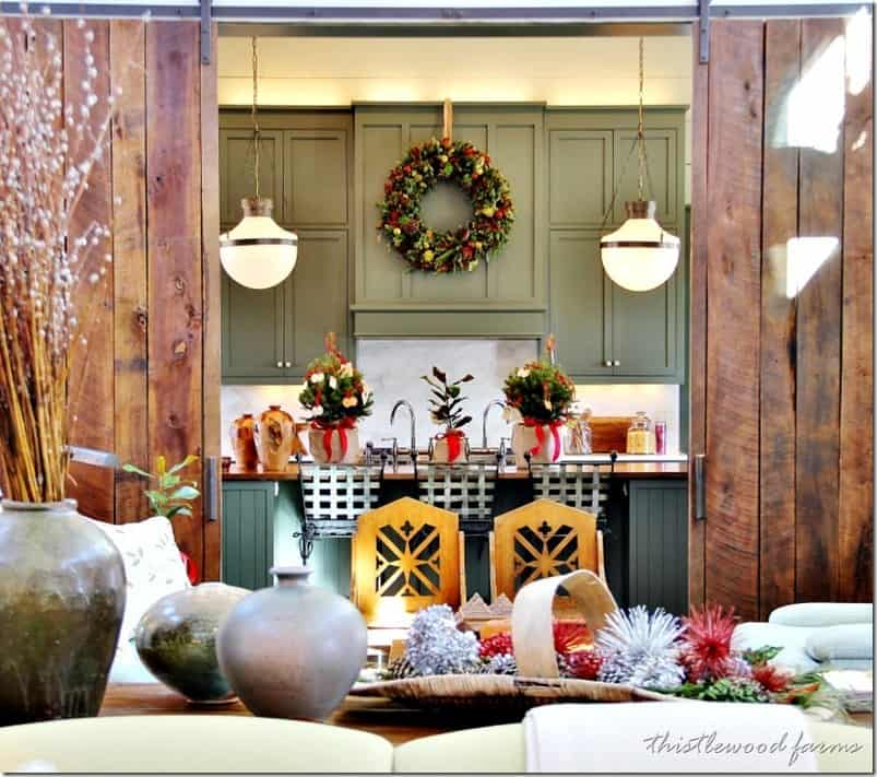Southern style kitchen decorated for christmas with holly wreaths and greenery