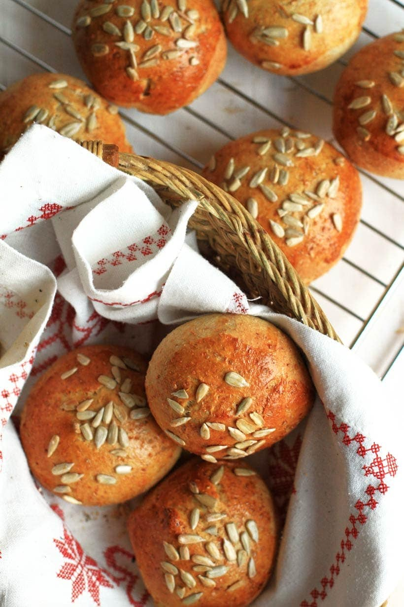 Perfect freezer meals: Whole wheat bread rolls with sunflower seeds in a bread basket.