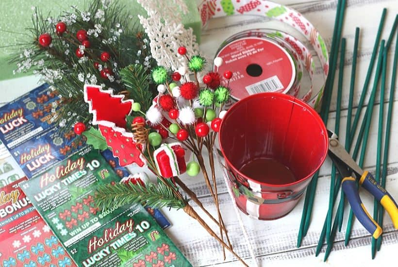 Ring in the holiday season with this easy gift idea. Share some luck this holiday season by giving this DIY New Jersey Lottery Scratch Off Ticket Christmas Arrangement. This is an easy DIY Christmas craft. #ad #BestGifts, #TheGiftThatKeepsOnGiving #NewJerseyLottery #NJLotteryHoliday