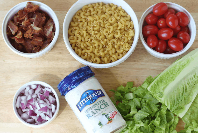 Everything is better with bacon! It's picnic season and this BLT Pasta Salad is the perfect summer salad recipe! This pasta salad recipe is filled with crispy bacon, fresh tomatoes and romaine. It is dressed with Litehouse Ranch Dressing. Save this kicked up macaroni salad recipe for your next backyard BBQ or picnic. #bltpastasalad #BLT #pastasalad #bacon #summersalad #macaronisalad