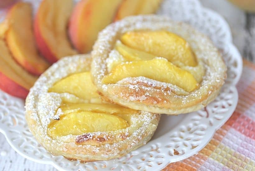 Nothing can go wrong on a day that starts out with these Peach Breakfast Danish made with puff pastry, fresh peaches and a sweet cheese filling. You will love this award-winning peach recipe. This easy breakfast danish is perfect to make when peaches are in season. This recipe can be served as a delicious peach dessert recipe or breakfast recipe.