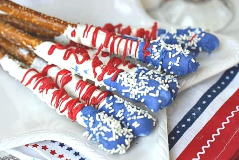 How about a fun patriotic recipe everyone will enjoy? These red, white and blue Stars And Stripes Dipped Pretzels will be a hit at your next patriotic celebration. This dipped pretzel recipe is easy to make and is perfect to serve at a party.
