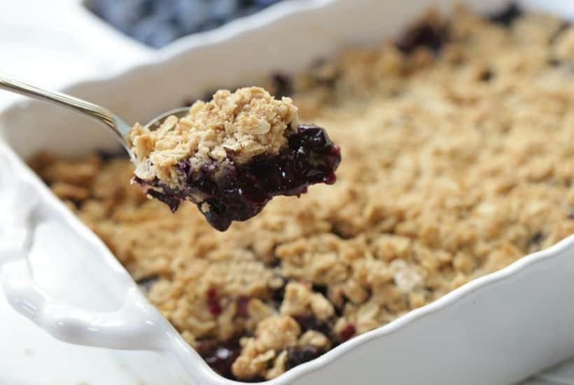 It's blueberry season! This easy blueberry crisp recipe it the perfect way to celebrate. This fruit crisp is a super simple summer dessert and perfect with a dollop of ice cream. #blueberrycrisp #blueberryrecipe #summerdessert
