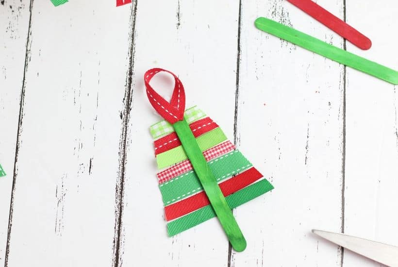 These Ribbon Tree Ornaments are a fun Christmas craft to make. Use any colorful ribbon to make these easy ornaments for your Christmas tree. This is a fun Christmas craft for kids too. #ornaments #ChristmasTree #ChristmasCraft