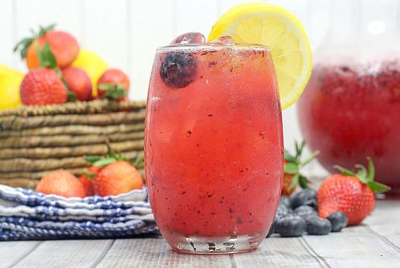 This Refreshing Mixed Berry Lemonade recipe is made with fresh summer berries and fresh-squeezed lemonade. Pull up a chair and enjoy a glass of this lemonade recipe. This summer mocktail can easily be made into a summer cocktail by adding some bourbon to the recipe for a Berry Bourbon Lemonade Cocktail.