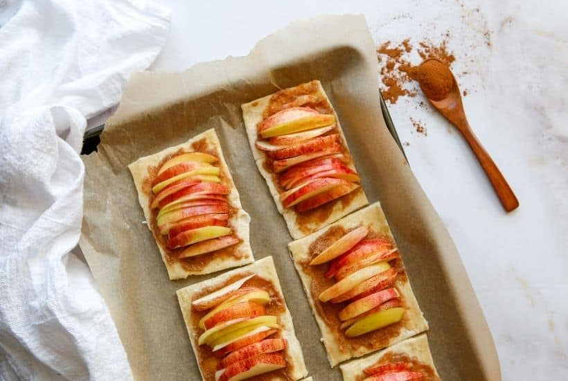 They may look fancy, but these easy puff pastry apple tarts are anything but! This easy rustic apple tarts recipe is so delicious. Fill these apple pastries with your favorite apple variety, cinnamon and sugar.