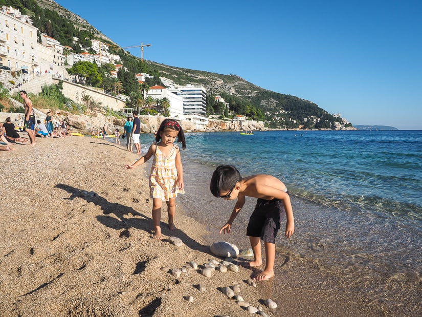 Our kids looking for rocks on Banje Beach in Dubrovnik