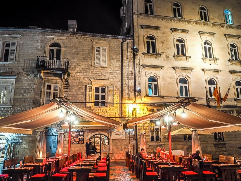A restaurant patio in Kotor at night