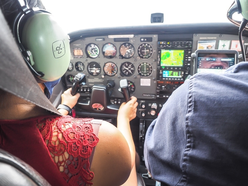 My wife Emily flying the airplane on our Fort Mac aerial tour