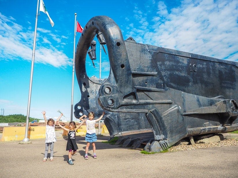 Children and dragline bucket at the Fort McMurray Giants of Mining
