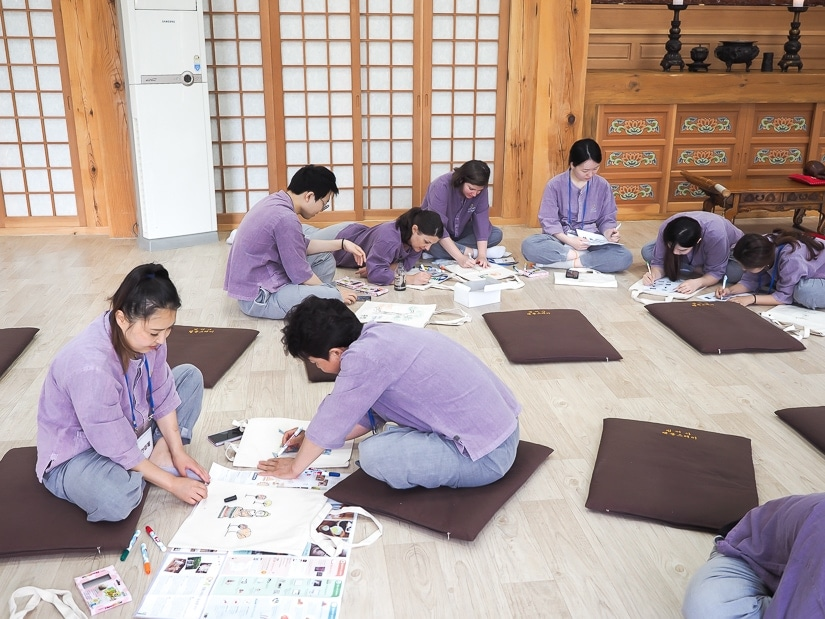 Beomeosa temple stay participants coloring cloth bags