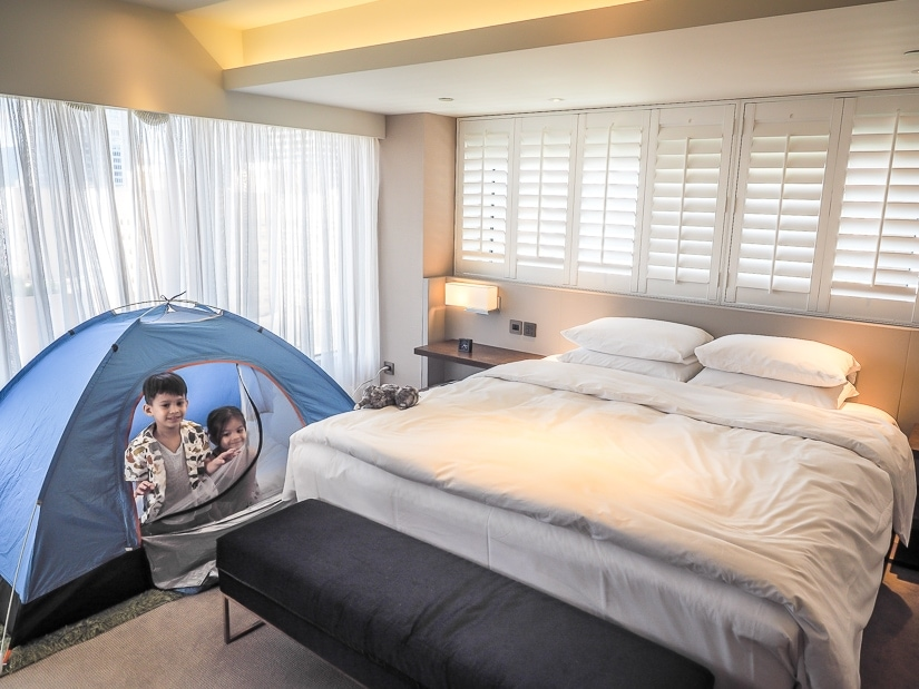 Kids in the tent in our suite at Grand Hyatt Taipei
