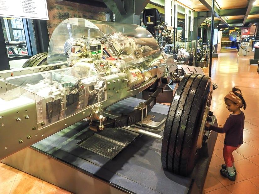 My daughter looking at a car's engine inside Rahmi M. Koc Museum, Istanbul