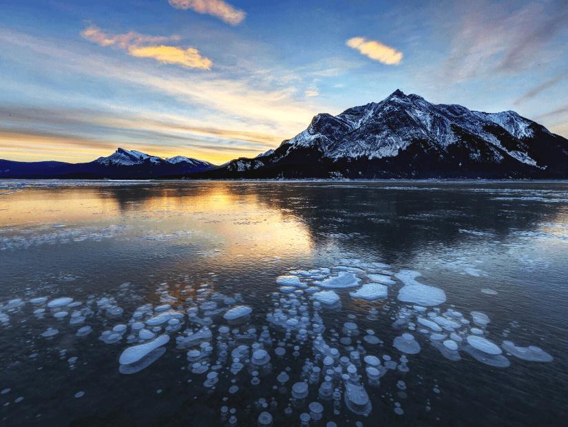 Ice bubbles at Abraham Lake Alberta at sunrise