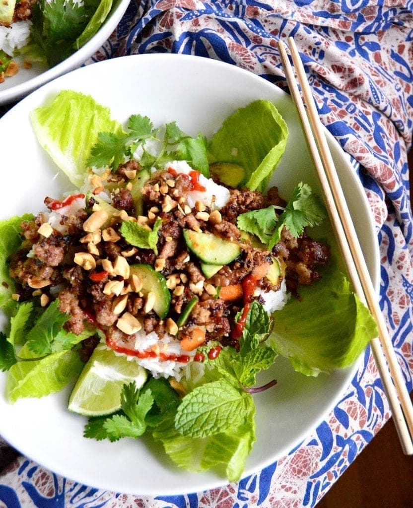 Vietnamese Caramelized Ground Pork is addicting. Perfect for topping a rice or noodle bowl, making lettuce wraps, or even stuffing between a bun, this garlic, peppery, sweet and sourish pork is beyond tantalizing. #VietnameseFood #groundpork #Vietnmeserecipes www.thisishowicook.com