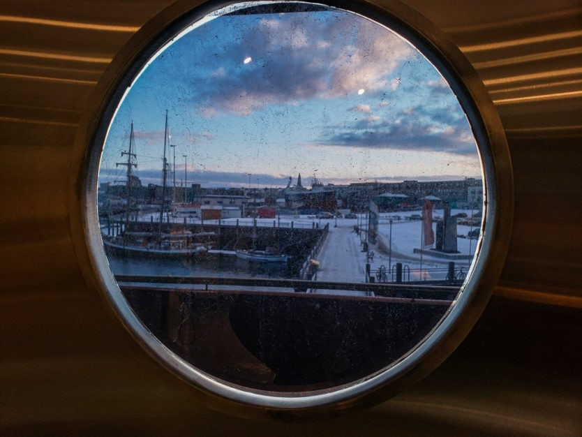 reykjavik maritime museum views through a porthole looking out onto the harbour