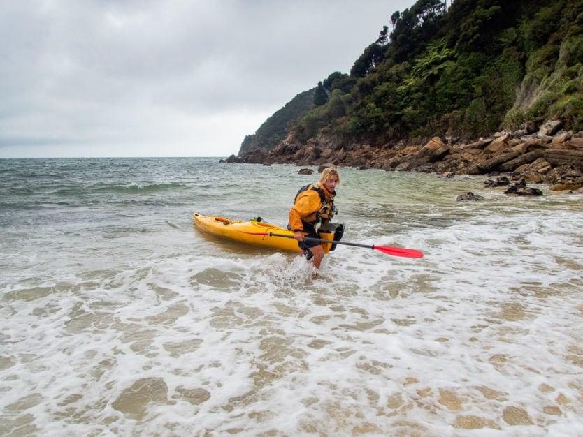 Abel Tasman Kayaks guide explaining how to enter the kayak in Awaroa Bay