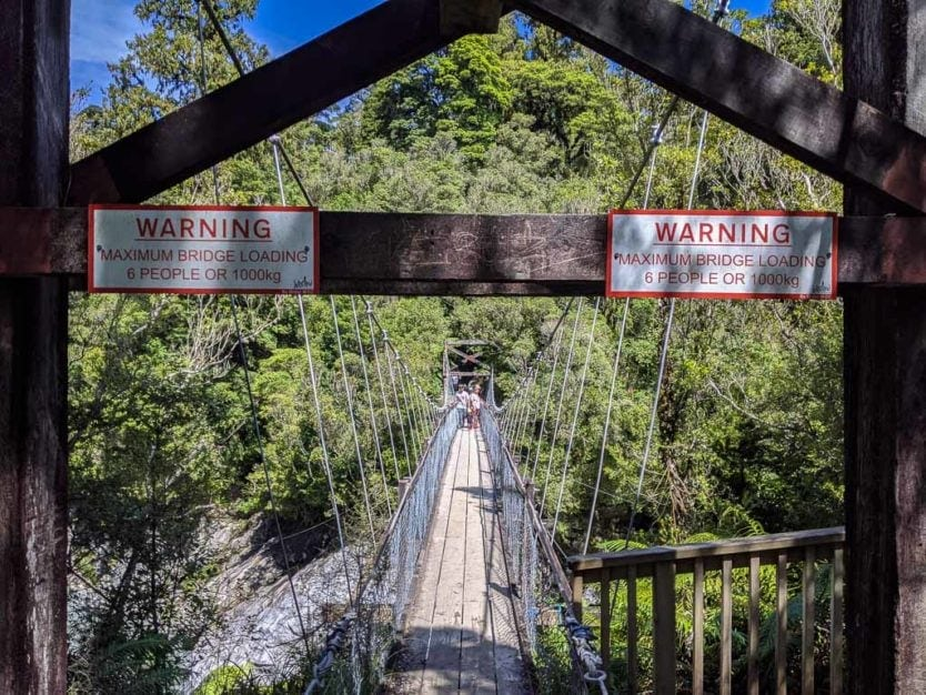 Warning Sign stating a limit of 6 people or 1,000kg on Bridge over Hokitika Gorge on the Hokitika Gorge Walk