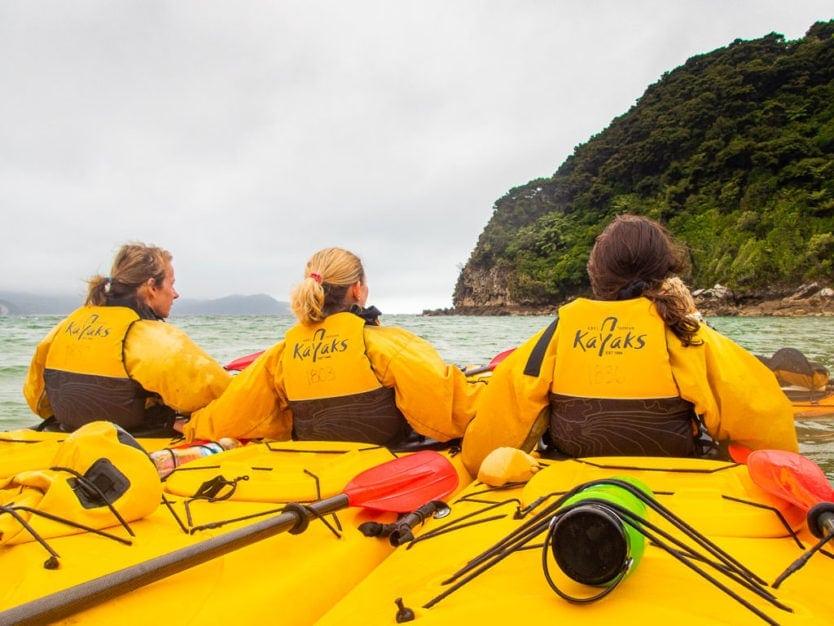 getting a kayaking lesson in Awaroa Bay with Abel Tasman Kayaks