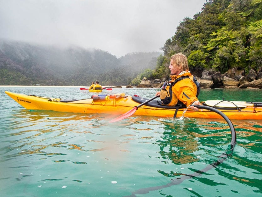 drinking the fresh spring water in abel tasman national park near Bark Bay
