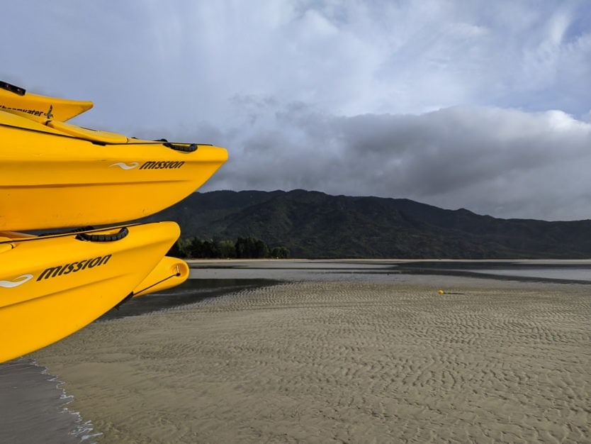 sea kayaks about to go on an adventure in abel tasman national park