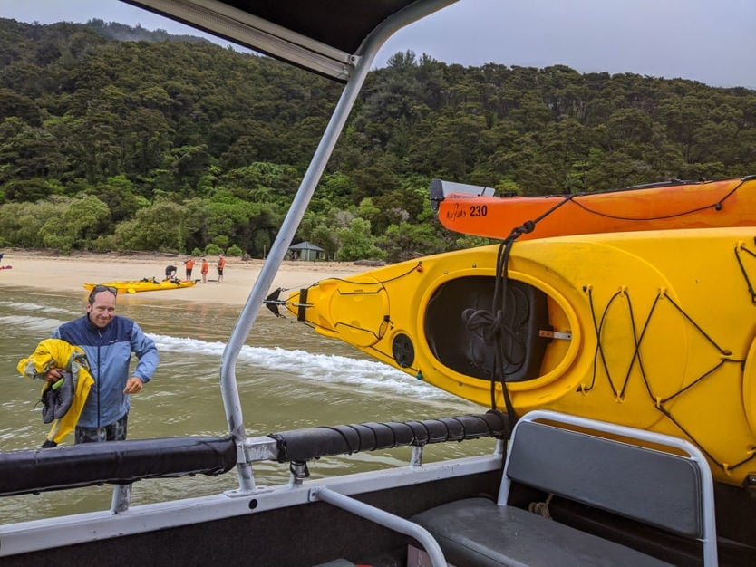 unloading the sea kayaks from the water taxi in abel tasman national park